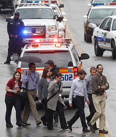 Police evacuate people from the Western Psychiatric Institute and Clinic of University of Pittsburgh Medical Center in Pittsburgh, Pennsylvania after several people were shot in the building on March 8, 2012.