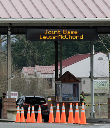A guarded gate at Joint Base Lewis McChord is shown Sunday, March 11, 2012