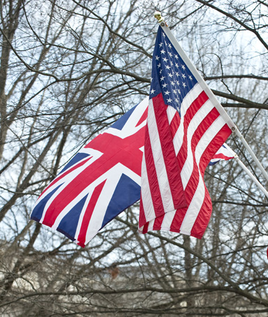 The Union Jack and the Stars and Stripes float in front of the White House in Washington on March 12, 2012, on the eve of the arrival of British Prime Minister David Cameron for an official visit