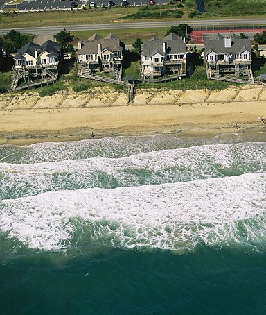 Outer Banks, North Carolina. Aerial view of beachfront homes and sand fences for erosion control.