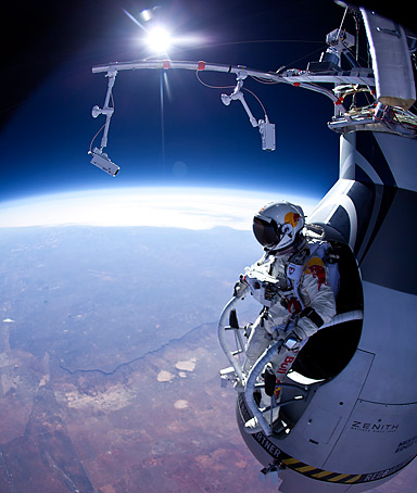 In this photo provided by Red Bull Stratos, Felix Baumgartner prepares to jump during the first manned test flight for Red Bull Stratos over Roswell, N.M. on Thursday, March 15, 2012.