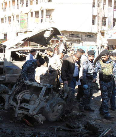 Iraqi security forces inspect the site of a bomb attack in Hilla, 100 km (60 miles) south of Baghdad, March 20, 2012