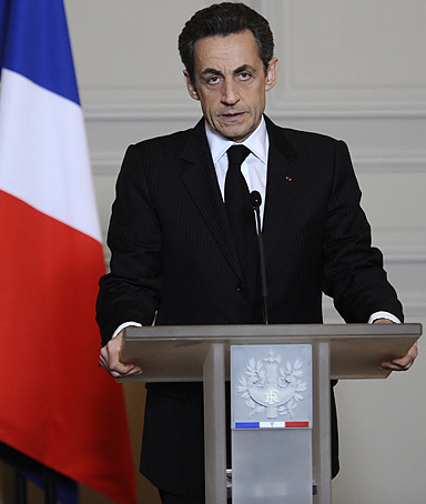 France's President Nicolas Sarkozy speaks during a press point at the presidential Elysee Palace in Paris, after the today's shooting of the
