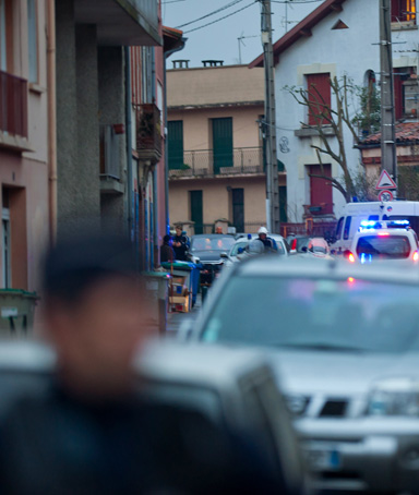 Police surround a property during an operation to arrest the man suspected of killing seven victims including three children in separate gun attacks on March 21, 2012 in Toulouse, France