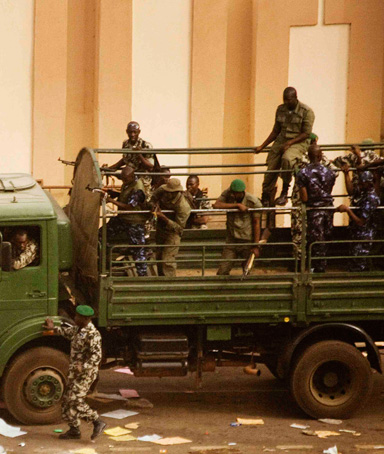 Malian soldiers and security forces gather at the offices of the state radio and television broadcaster after announcing a coup d'etat, in the capital Bamako, March 22, 2012