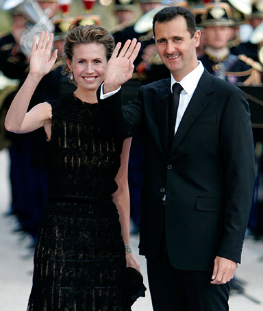In this July 13, 2008, file photo, Syrian President Bashar Assad and his wife Asma arrive for a formal dinner after a Mediterranean Summit meeting at the Petit Palais in Paris