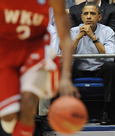 Prime Minister David Cameron and US President Barack Obama at the Dayton, Ohio Basketball Arena in Ohio as they watch a basketball game. Picture date: Tuesday March 13, 2012.