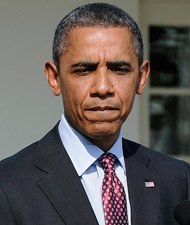 U.S. President Barack Obama pauses while remarking on the case of shooting victim Trayvon Martin during a news event in the Rose Garden at the White House in Washington, March 23, 2012.