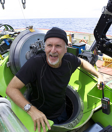 Explorer James Cameron emerges from the DEEPSEA CHALLENGER submersible after his successful solo dive March 26, 2012 to the Mariana Trench, the deepest part of the ocean.