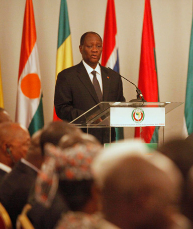 Ivory Coast President and current Economic Community of West African States (ECOWAS) head Alassane Ouattara makes a speech on the situation of a coup in Mali during an extraordinary meeting of the ECOWAS in Abidjan March 27, 2012