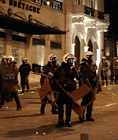 Riot police stand in Athens on April 4, 2012 during clashes with demonstrators