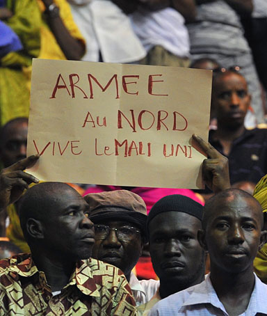Malian men take part in a meeting of residents from Northern Mali, in Bamako on April 4, 2012