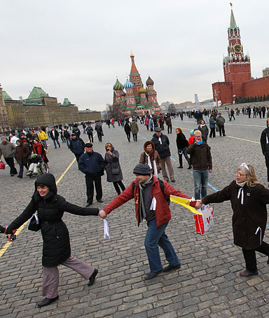 Anti-Putin opposition activists form a chain of hands as they attend an unsanctioned rally at Red Square on April 8, 2012 in Moscow, Russia.