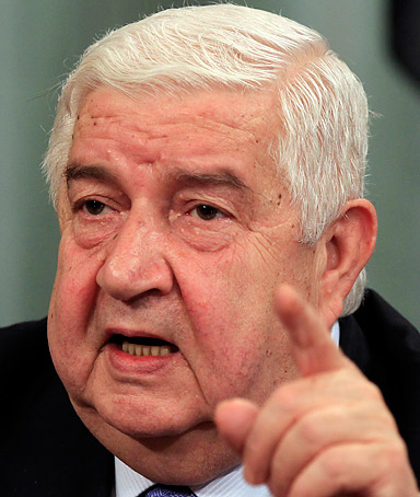 Syrian Foreign Minister Walid Moallem speaks during a news conference with Russian Foreign Minister Sergey Lavrov, not seen, in Moscow, Tuesday, April 10, 2012.