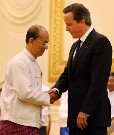 Prime Minister David Cameron (right) meets with President Thein Sein on April 13, 2012 in Naypyidaw, Burma