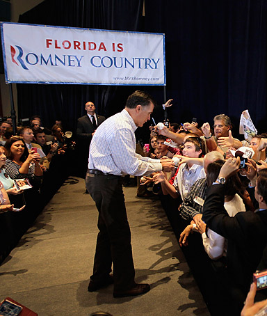 Republican presidential candidate, former Massachusetts Gov. Mitt Romney greets people as he attends a campaign rally at the West Palm Beach Convention Center on January 12, 2012 in West Palm Beach, Florida.