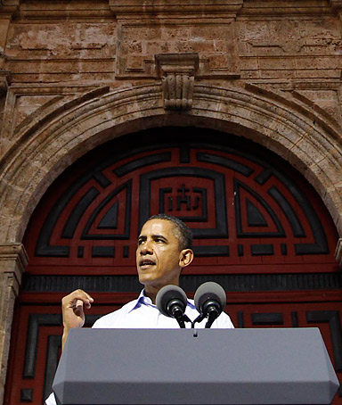 U.S. President Barack Obama addresses the audience outside the San Pedro church during a ceremony with his Colombian counterpart Juan Manuel Santos in San Pedro Square in Cartagena, April 15, 2012.