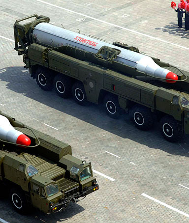 Rockets are carried by military vehicles during a military parade to celebrate the centenary of the birth of North Korea's founder Kim Il-sung in Pyongyang on April 15, 2012