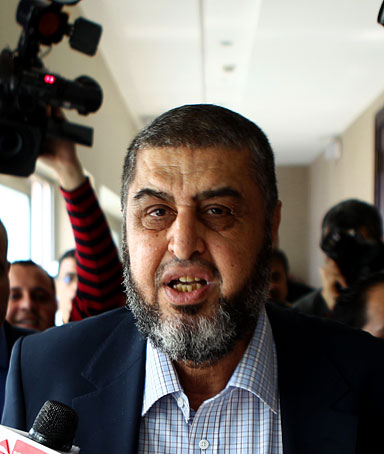 Khairat el-Shater, the presidential candidate of Egypt's Muslim Brotherhood, leaves following a press conference in Cairo on April 9, 2012.