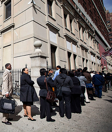 Job seekers wait in line to enter the Dr. King career fair in the Brooklyn borough of New York, U.S., on Thursday, April 12, 2012.