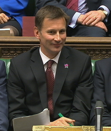 Britain's Culture Secretary Jeremy Hunt (C) sits flanked by Prime Minister David Cameron (R) and Deputy Prime Minister Nick Clegg during Prime Minister's Questions in parliament in this still image taken from video in London April 25, 2012