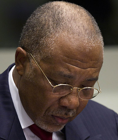 Former Liberian President Charles Taylor takes notes at the start of the judgement hearing of his trial on April 26, 2012 at the Special Court for Sierra Leone, based in Leidschendam outside The Hague.