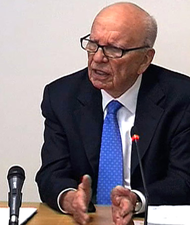 A video grab from pooled footage taken inside the Leveson Inquiry shows former News Corp chief Rupert Murdoch giving evidence at the Leveson Inquiry into press standards at the High Court in London on April 26, 2012.