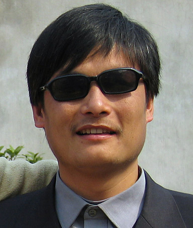 This picture taken on March 28, 2005 shows blind activist Chen Guangcheng outside a house in Dondshigu village, in northeast China's Shandong province.