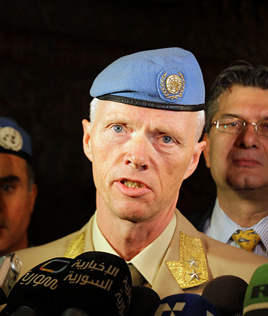 Norwegian Major General Robert Mood, who negotiated with Syrian authorities the conditions for the deployment of an advance team, speaks to the press upon his arrival at Damascus airport on April 29, 2012
