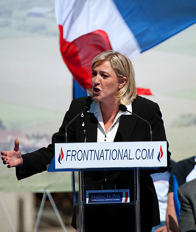 French far right party Front National (FN) former presidential candidate Marine Le Pen gestures as she gives a speech during the FN's annual celebration on May 1, 2012 in front the Opera in Paris