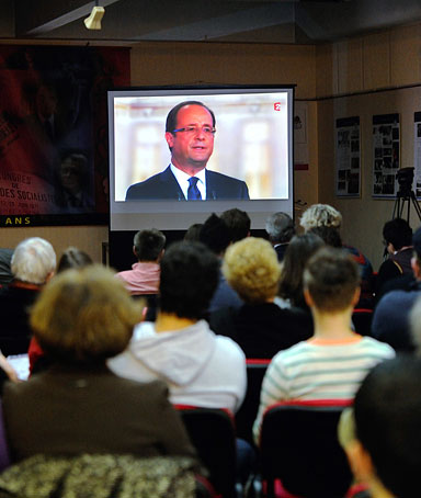 Socialists militants gather to watch on TV the televised national debate between the two candidates for the 2012 French presidential election