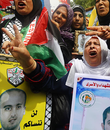 Palestinian women chant slogans during a rally in Gaza City in support of more than a thousand prisoners who are on an open-ended hunger strike in Israeli jails on April 30, 2012.