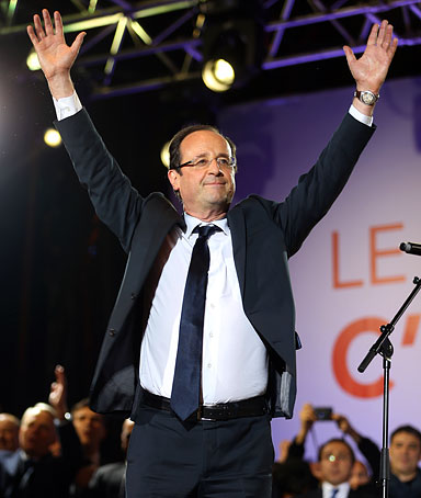 France's Socialist Party (PS) newly elected president Francois Hollande celebrates at the Place de la Bastille in Paris on May 7, 2012 after the announcement of the first official results of the French presidential second round