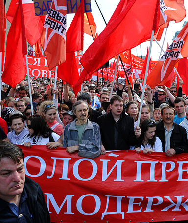 Russian people march along a street during an opposition's protest rally in Moscow on May 6, 2012