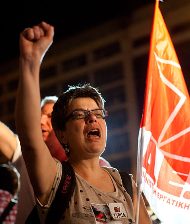 Supporters of Alexis Tsipras, the head of Syriza, celebrate outside the political party's election tent after beating the Pasok party in the parliamentary elections in Athens, Greece, on Sunday, May 6, 2012