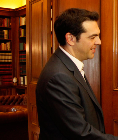 Leftist Syriza coalition leader Alexis Tsipras (left) shakes hands with Greek President Carolos Papoulias at the Presidential Palace, central Athens, May 8, 2012