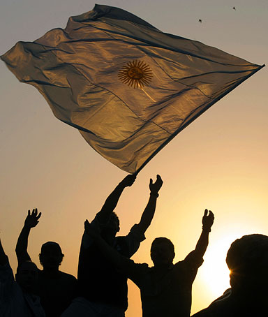 A man makes flutter an Argentine national flag during a farmers' protests against the government's grain tax bill in Palermo neighbourhood in Buenos Aires on July 15, 2008.