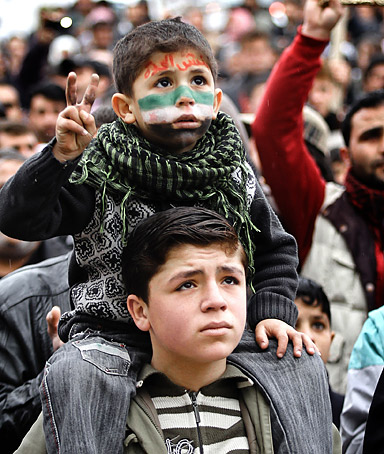 Two young boys participate in an anti�Assad protest in the town of Binnish in Syria.