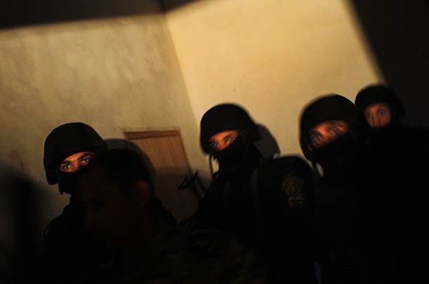 Officers from a special security unit loyal to President Mahmoud Abbas conduct a raid in a village near Hebron.