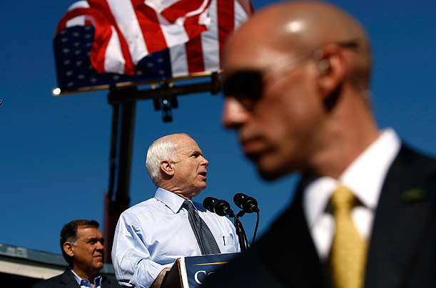 A U.S. Secret Service agent stands in front of Republican presidential nominee Sen. John McCain  as he addresses a campaign rally in Miami, Florida.
