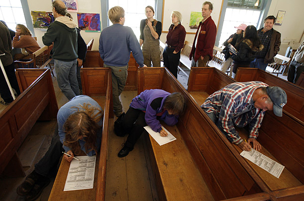 Voters use benches to cast their ballots at a voting station in Calais, Vermont