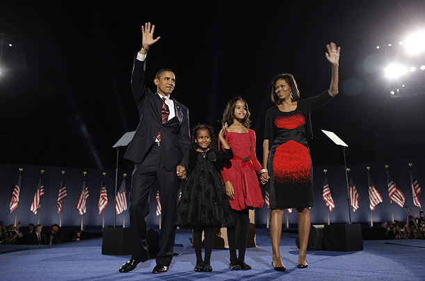President-elect Barack Obama, his wife, Michelle and two daughters, Malia, 7. and Sasha, 10, wave to the crowd in Chicago.