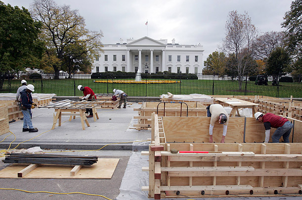 Workers begin building the presidential reviewing stand for Inauguration Day ceremonies.