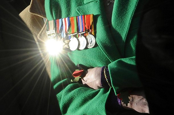 Sunlight glints off the medals of a veteran during the the Armistice Day service at The Cenotaph in London.