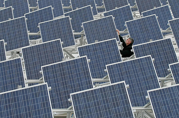 Solar panels are checked on the roof of a building in Soemmerda, Germany.