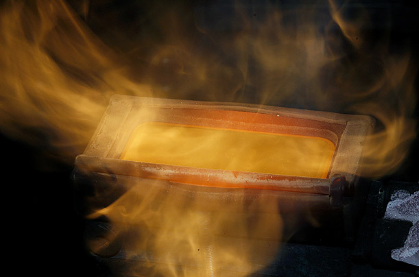 A freshly cast bar of gold rests in a mould at a plant of the gold refiner and bar manufacturer Argor-Heraeus SA in the southern Swiss town of Mendrisio.