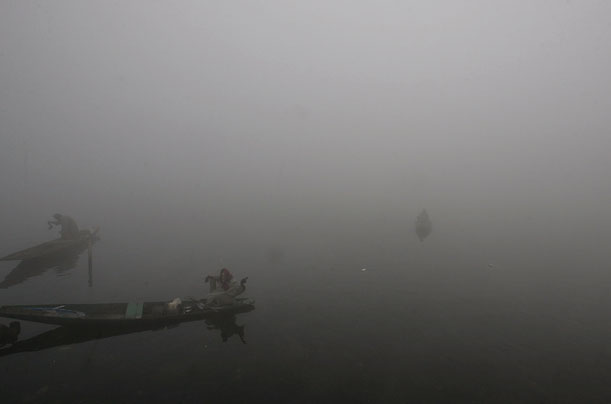 A boatman on Dal Lake on a foggy morning in the Indian-administered Kashmiri city of Srinagar.