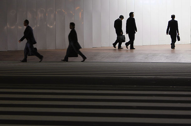 Pedestrians in a business district of Tokyo, Japan, whose government said today that a big increase in public spending is unavoidable in the short term to ease Japan's recession.