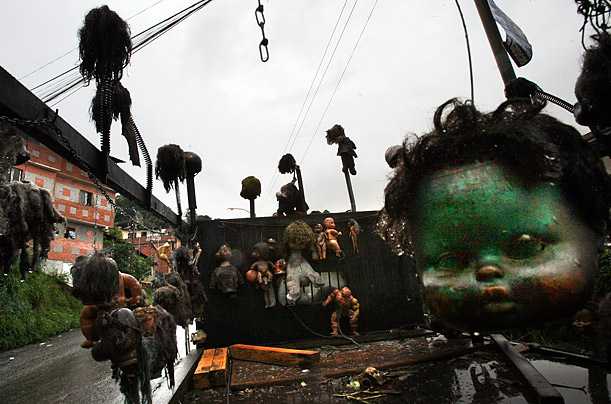 Disembodied dolls hang from a truck owned by a local artist in Caracas, Venezuela.