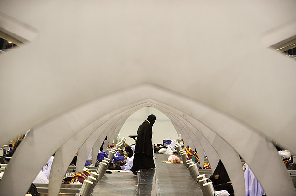 A Thai Muslim woman walks between luggage conveyor belts in the departures hall of Bangkok's Suvarnabhumi airport. The airport was shutdown by anti-government protestors.